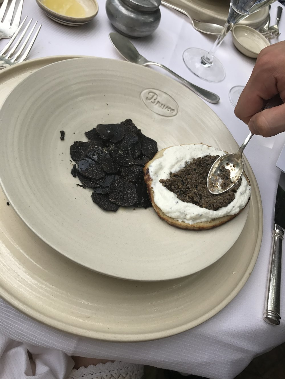 Whipped sour cream infused with raw black Tuber Melanosporum Truffles topped with a caviar of truffles.