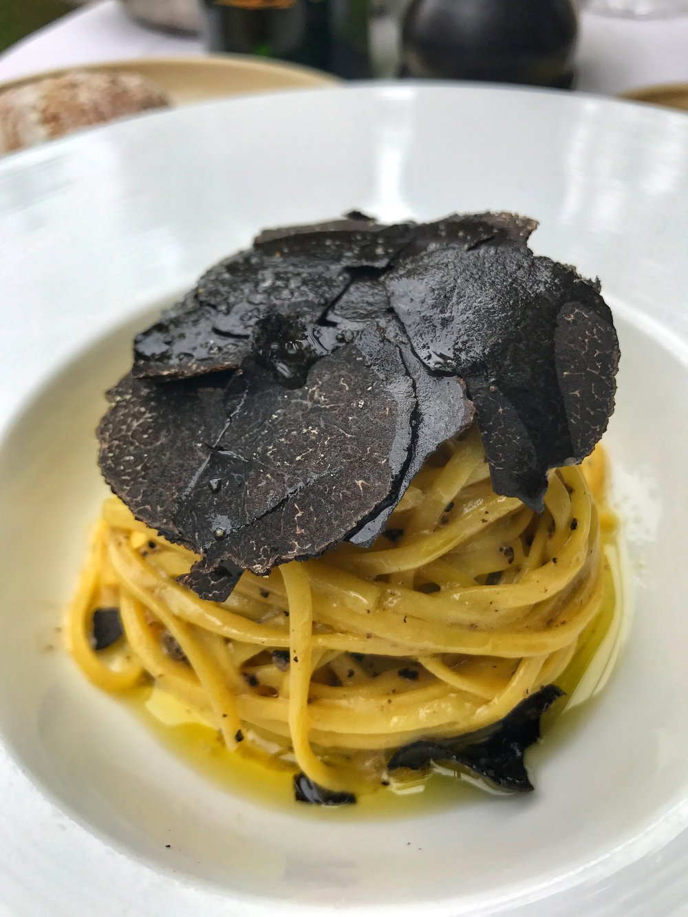 Fresh pasta served with a light creamy truffled sauce and shaved truffle on top.