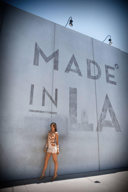 Maureen Kragt, fashion Influencer posing on Melrose, Los Angeles in an For Love & Lemons dress.  www.maureenkragt.com