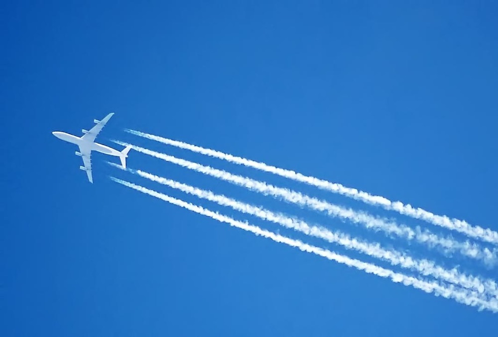 A photo of a plane emitting mind controlling chemicals. Or are they weather controlling? Either way, we can all agree they're nefarious.