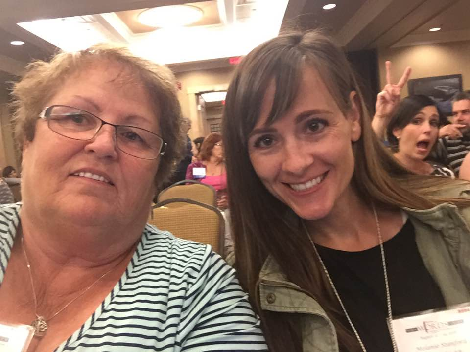 Me and my MIL Debbie before the keynote speeches (plus a photobomber in the background!)