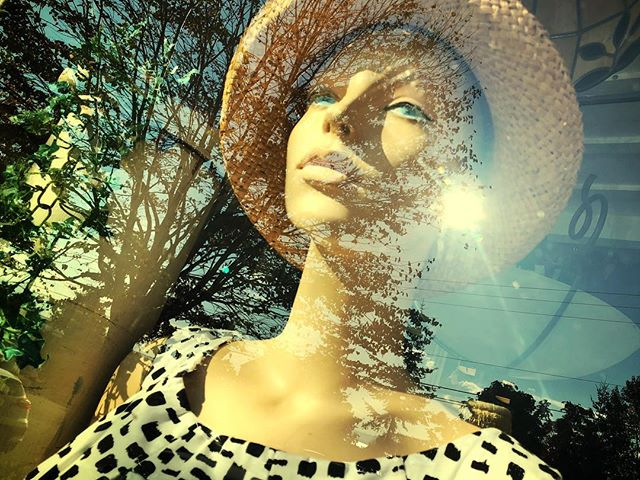 Window reflections, a mannequin, late sun #hometown #bellinghamwa #pacificnw #mannequin #woman #women #model #windowdisplay #reflect #reflection #looking #sun #sunset #bluesky #melancholy #earring #mouth #lips #dress #vintageclothing #vintage #hat #style #downtown #gaze #snapseed #iphone8plus