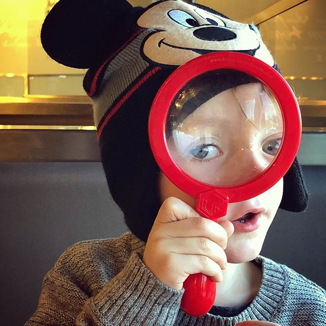 Not many people rock like this dude rocks. That's all I can say.  #kid #rocks #magnifyingglass #lookingatyou #mickeymousehat #mickeymouse #magnify #grandkid #thebest #blueeyes #littleman #heart #iphone8plus #snapseed