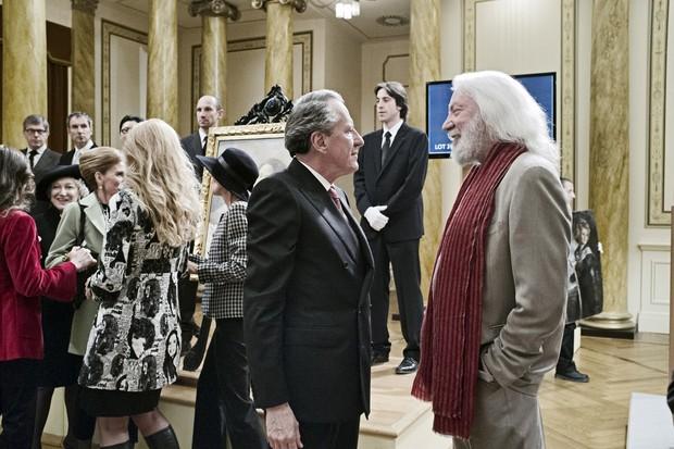 Virgil e seu companheiro de trapaças, Billy, vivido por Donald Sutherland