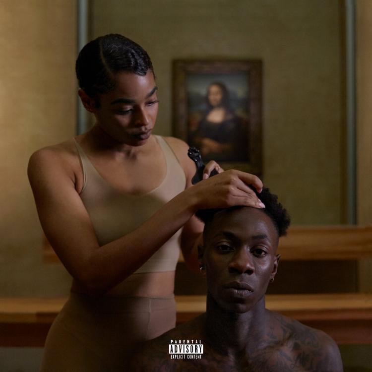 A capa do disco  'Everything Is Love'.  A Mona Lisa, desfocada ao fundo, atua como coadjuvante de um ato,ao mesmo tempo, sensível e extremamente político