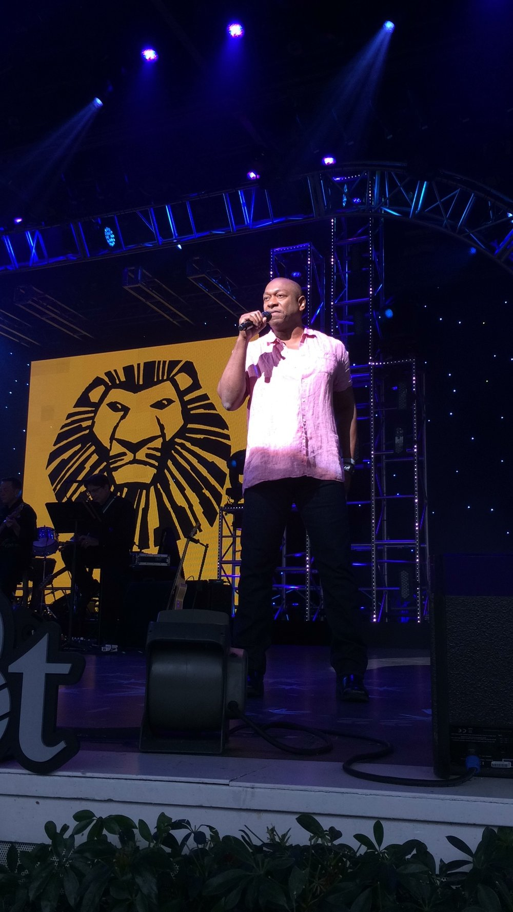 Alton Fitzgerald Brown performing one of his songs as Mufasa in The Lion King