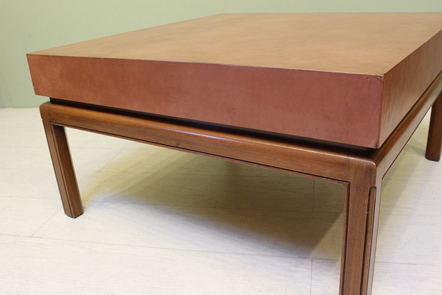 leather top coffee table in the style of edward wormley