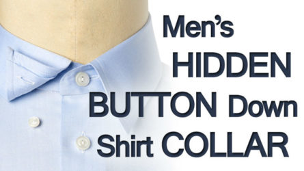 The hidden button down collar is a covert cousin to the button down collar. Why covert? Because the hidden button down collar employs hidden button loops under the collar instead of having the buttons go through the collar itself. On the underside of the collar, you will find a loop to which the button is fastened (see picture below). The end result is a streamlined button-less profile, but with the security of a buttoned collar. Why choose a hidden button down shirt collar? The answer is a matter of personal choice. Some people do not like two buttons protruding from their collar, while others like the simplicity and utility balanced with classic collar aesthetics.  If you are frustrated with a collar that does not sit properly and seek a streamline-look, then you should consider a hidden button down collar dress shirt. Although it is best to always wear a tie when wearing a suit, this is perfect if you tend to wear a suit without a tie. By doing so you can be assured that your collar will look crisp at all times without shirt collar stays or a protruding button (see picture below).