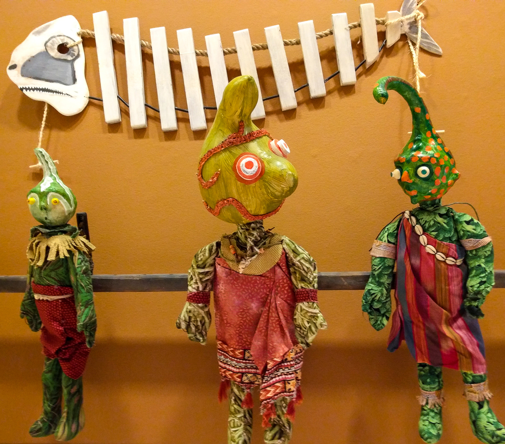 "puppets from ""Cannibal Island"" where head size matters"