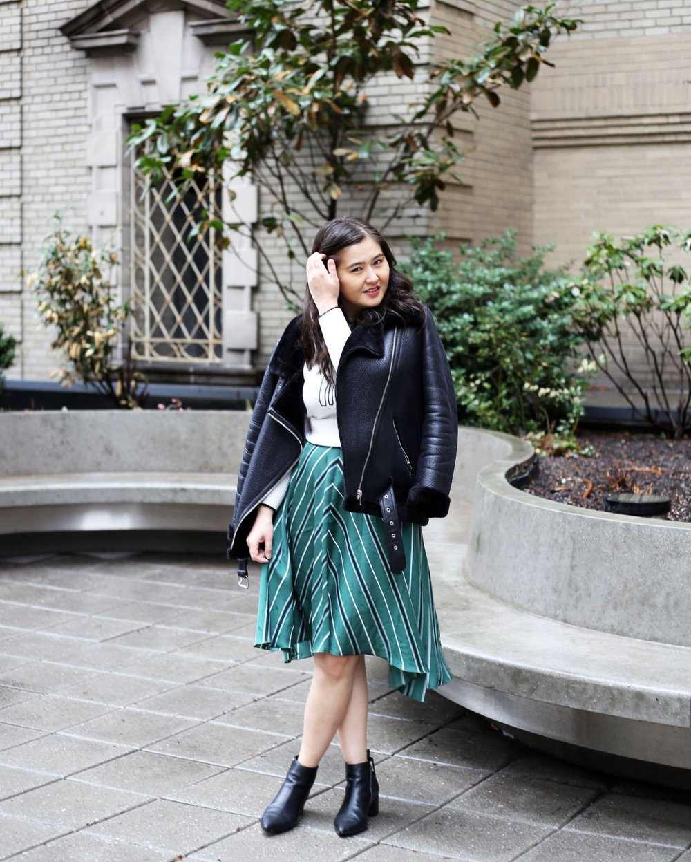 Jacket:  Zara . Skirt: H&M. Shirt:  Loft . Boots:  Everlane .