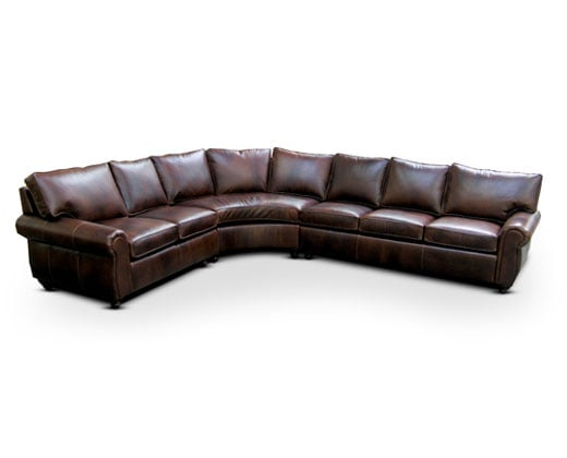 Custom sectional; semi-attached backs; loose seat cushions fasten to sofa.