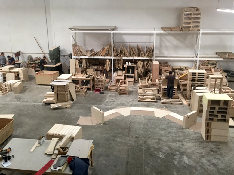 The view of the wood shop from above. This is where all the internal structures of FORTRESS Seating are designed.  In the case of unusual requests or extremely custom configurations, designs like the semicircular arrangement shown here are built to fit a template based on the customers' specifications and are often tested in plywood before the final wood structure is created.