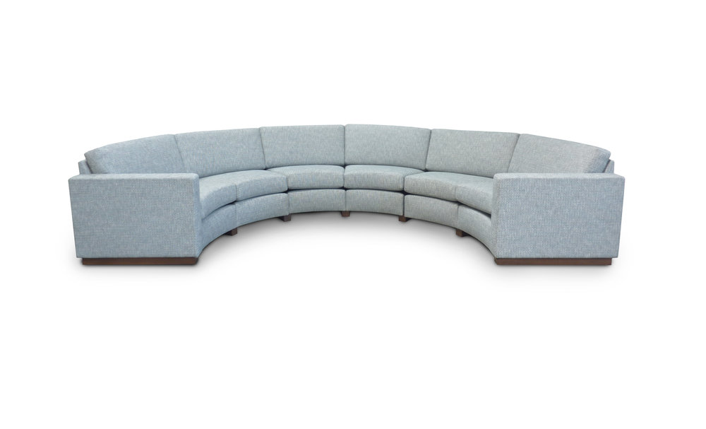 6-seat custom sofa sectional; Semi attached back; Loose seat cushions; plinth base