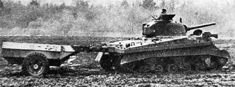 A Sherman Crocodile. This variant carried supplementary flamethrower goo in that trailer.
