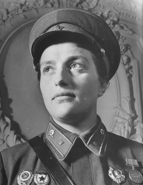 A slightly more formal photograph of Pavlichenko. Like most living soviets in the '40s, she didn't often put her rifle down for very long.