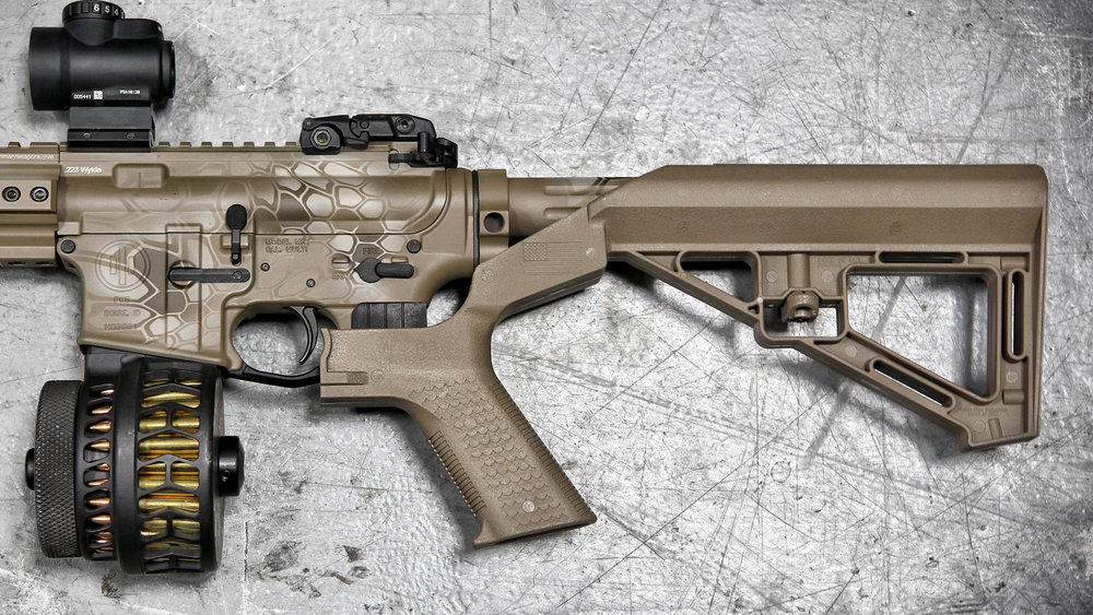 Well, the color's nice, but drum mags and that stupid goddamn bump-fire stock have ruined it. Also, about that magazine, wouldn't a cheaper way to jam your AR-15 just be to smear dirt on the rounds before you put them in the magazine?