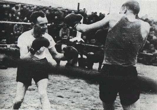 Based on the one photograph of the event, I'm guessing that what really happened is that two malnourished men put on boxing gloves they got from somewhere and traded punches, and it was the best entertainment anyone at the camp, prisoner or guard, had gotten for a long time.