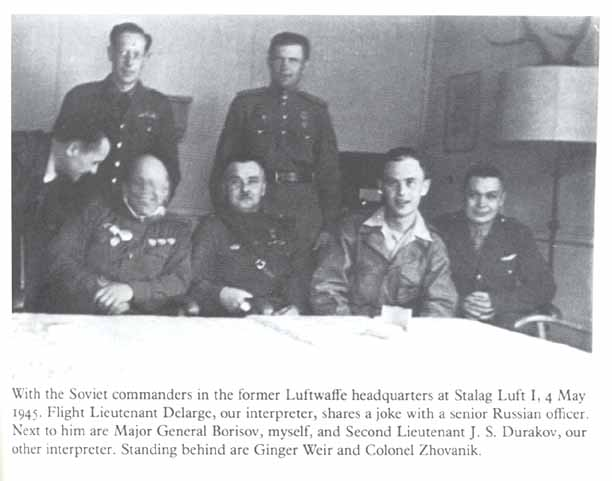 Here's Zemke with some more Soviets. Note F.LT. Delarge. Delarge also spoke Russian, so he could represent the prisoners alongside Zemke. Also note that officer on the left who didn't hold still for the camera. And finally, note General Borisov sitting to Zemke's right (viewer's left).