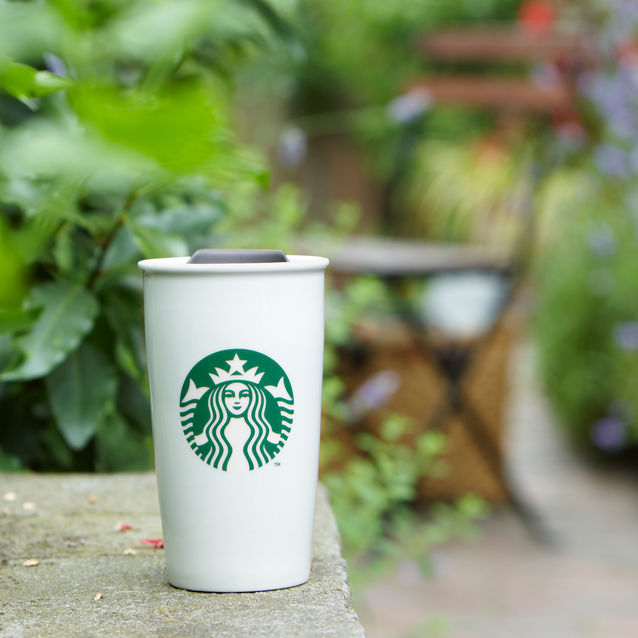 A large sized ceramic travel mug. As plain as it gets and for <$20 (Starbucks)