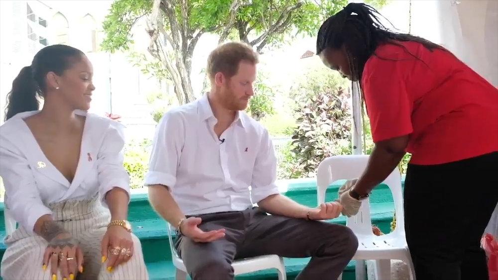 This is a video still from The Telegraph showing Prince Harry and Rihanna getting tested for HIV on World Aids Day in Bridgetown, Barbados, Dec. 1st, 2016.