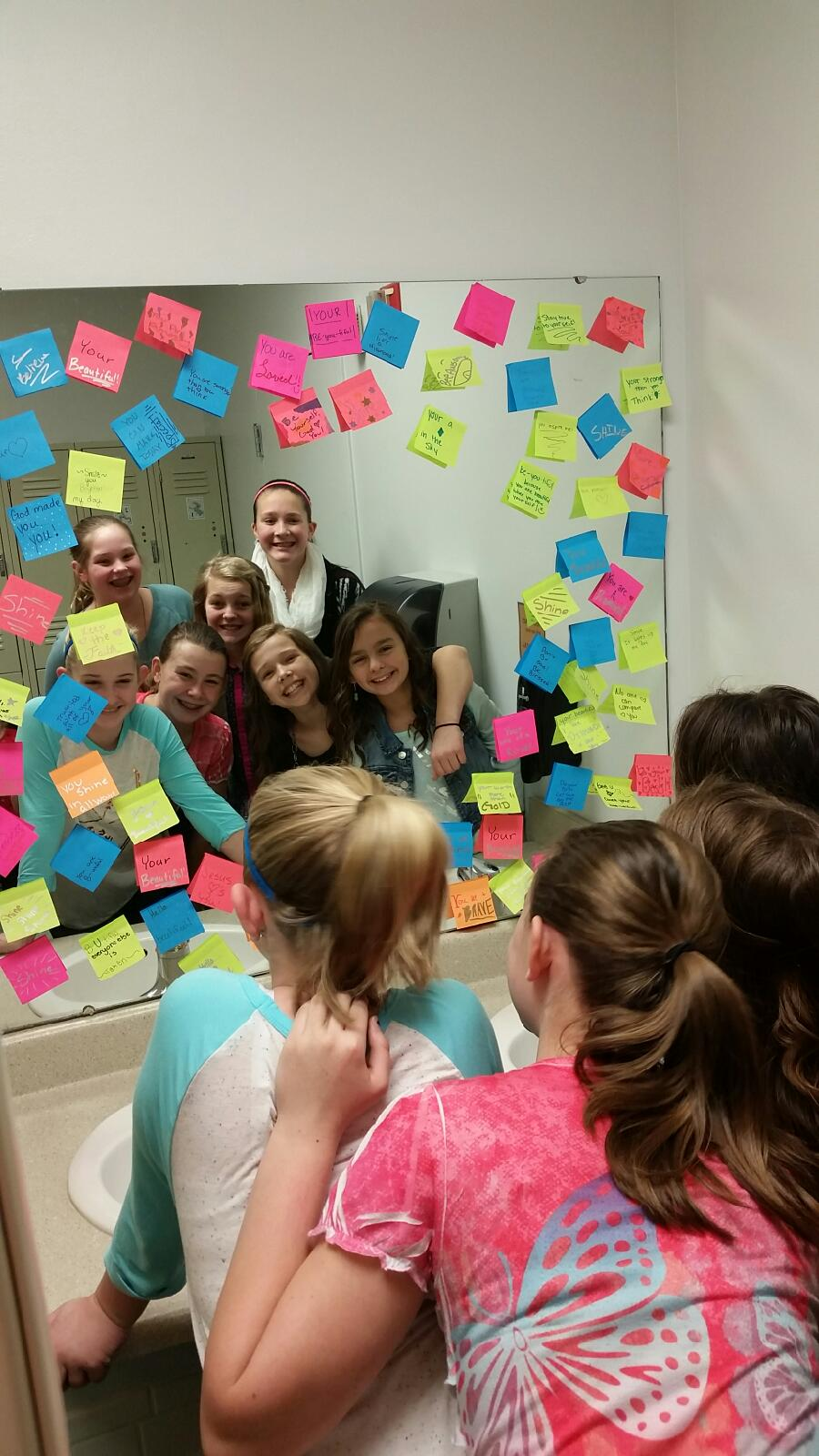 TC 6th grade girls spread encouragement with their Post-it notes