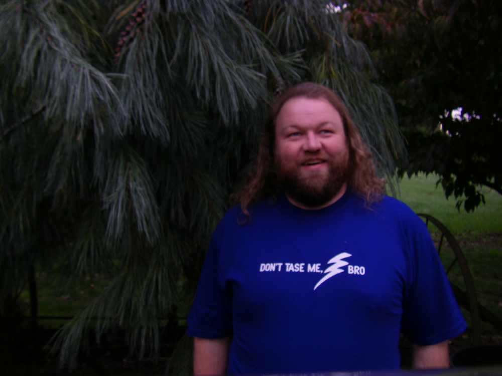"Erik wearing his ""Don't Tase Me Bro!"" T-Shirt, 2013."