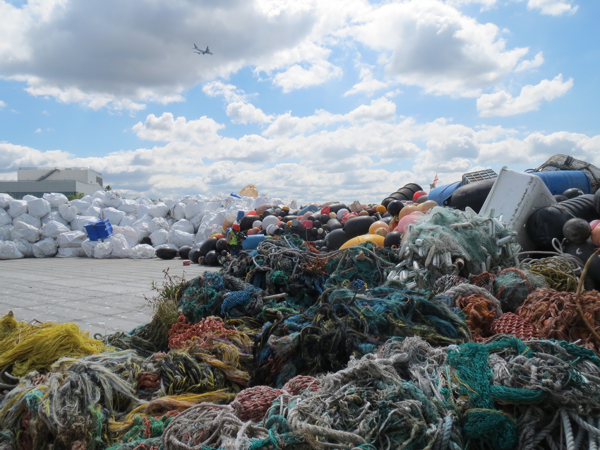 A barge docked in Seattle carries nearly 3,400 super-sacks of marine debris from remote beaches in Alaska and British Columbia, on August 6 2015.