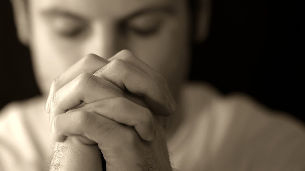 bigstock-Man-Praying-4785565.jpg