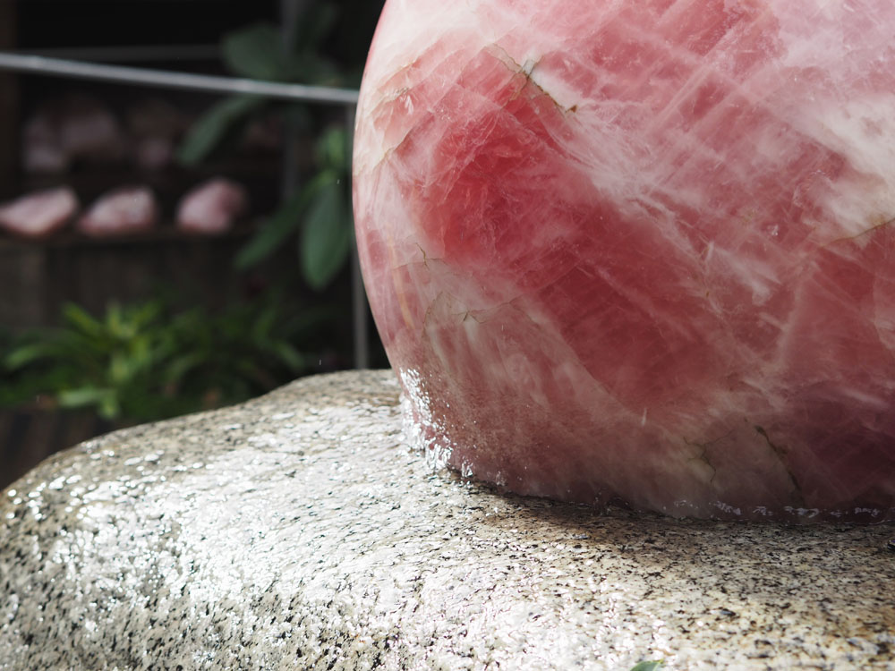 The heart of the property, a 310 kilogram rose quartz crystal sphere rotating in 0.3 mm of water