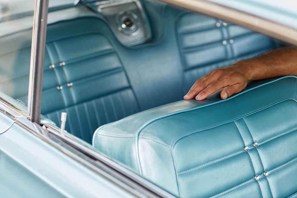 HAND-ON-BLUE-SEAT.jpg
