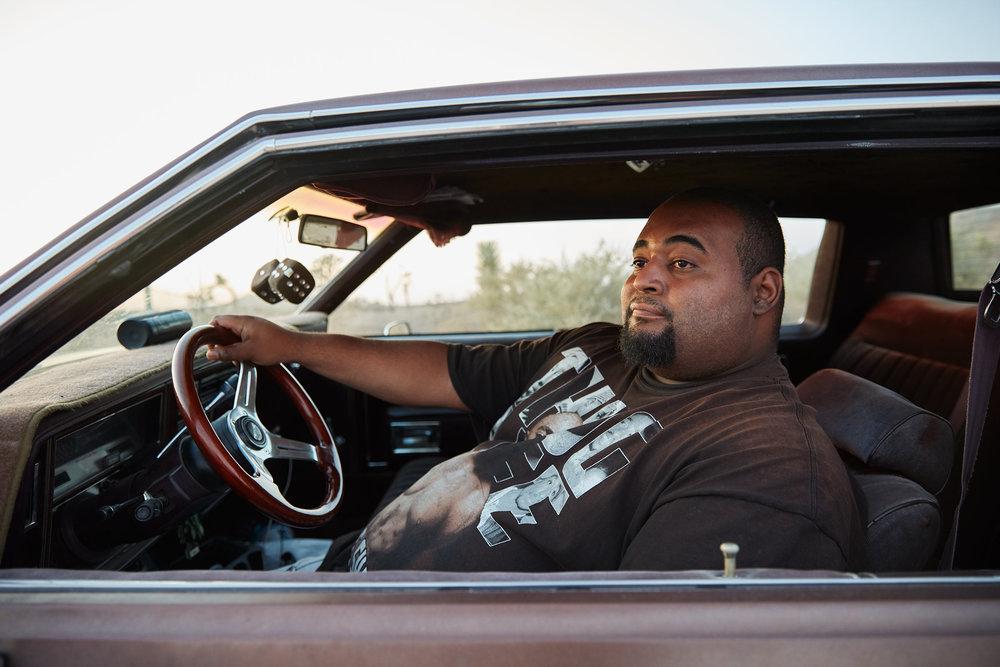 LARGE-GUY-IN-CAR.jpg