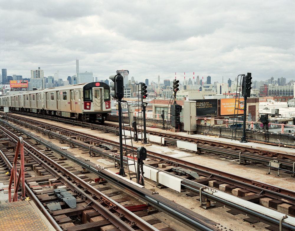 TRAIN-ON-TRACKS.jpg