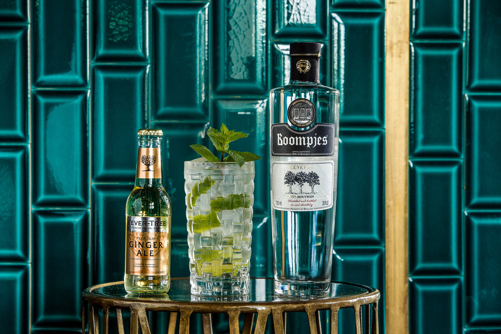 "Introducing The Bogi - Boompjes genever mixed with refreshing ginger ale, mint leaves and a slice of lime. Inspired from the Dutch ""borrel"", a typical Dutch thing, and as the dictionary would say - an informal social gathering, usually done after work."