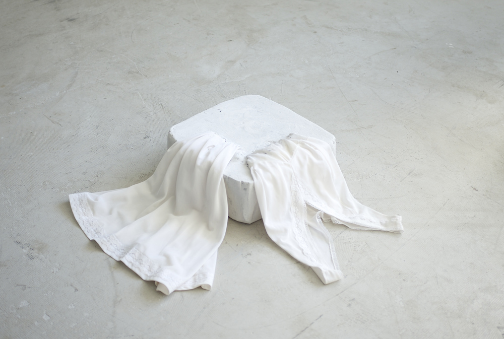 Float/soft skin  (2015),  57 x 54 x 14cm, plaster, inherited undergarment