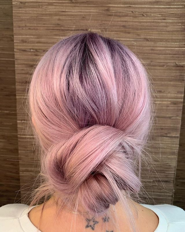 Slightly obsessed with this pastel dream and knot by our Master stylist @haleybonneyhair. • • #pastelhair #beauty #hair #pink #purple #rootstretch #balayage #updo #bohostyle #boho #haircolor #aveda #messybun #inspo #pastelpurplehair