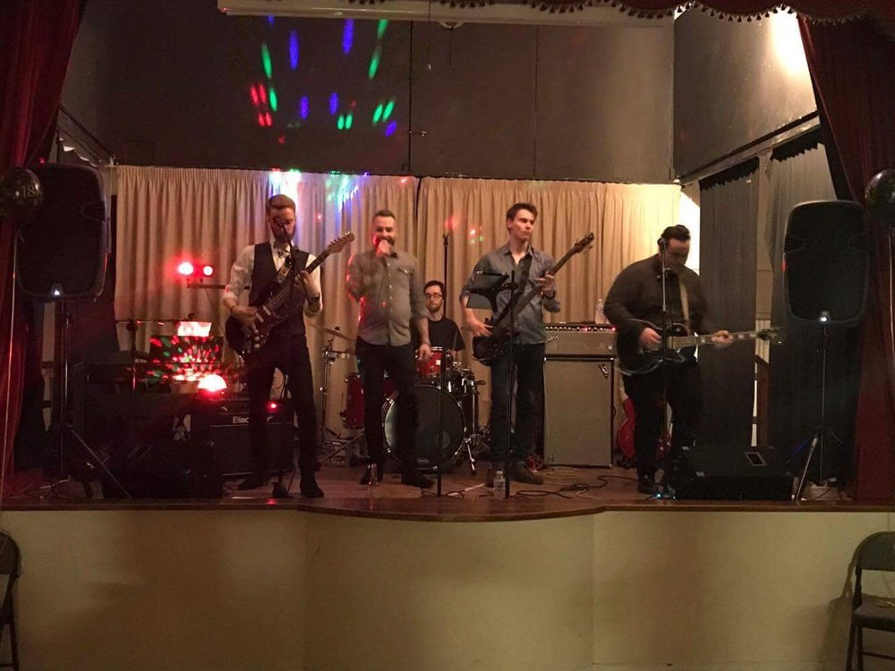 A band playing at an  18th Birthday party