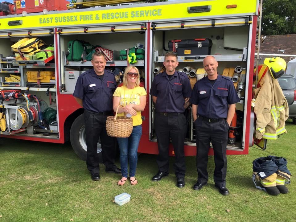 Amy & firemen at Fete.jpg