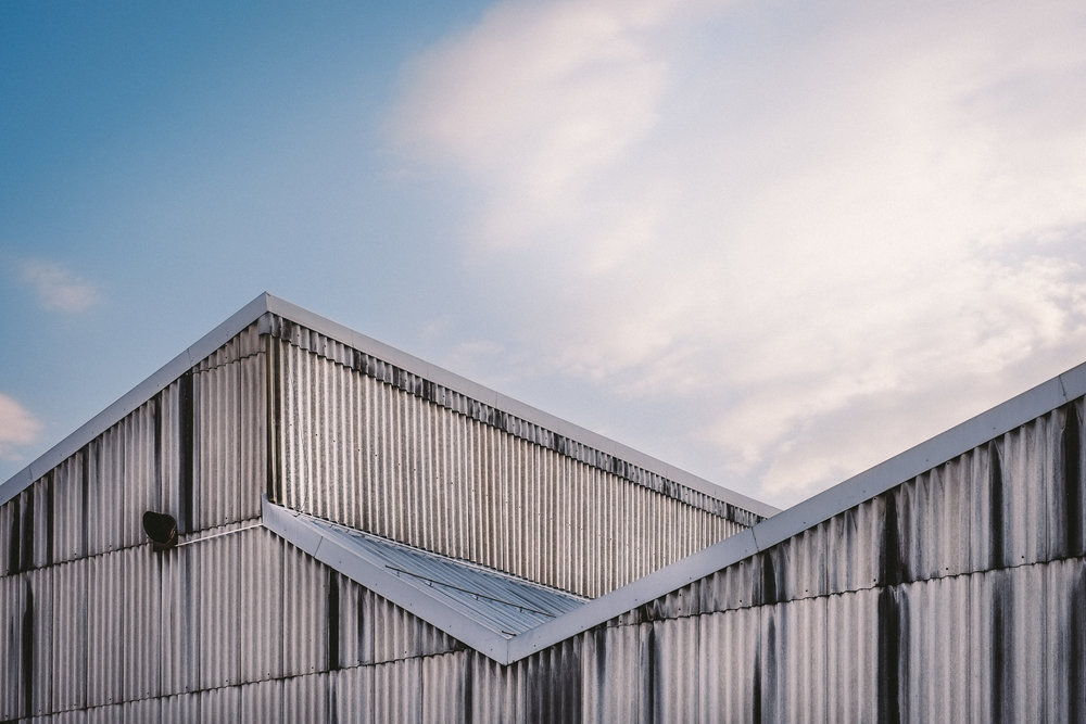 commercial roof metal roof vs spf roof