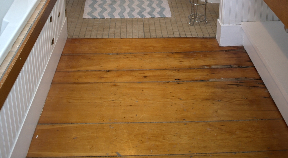 For reference, this is the original pine flooring in the bathroom.