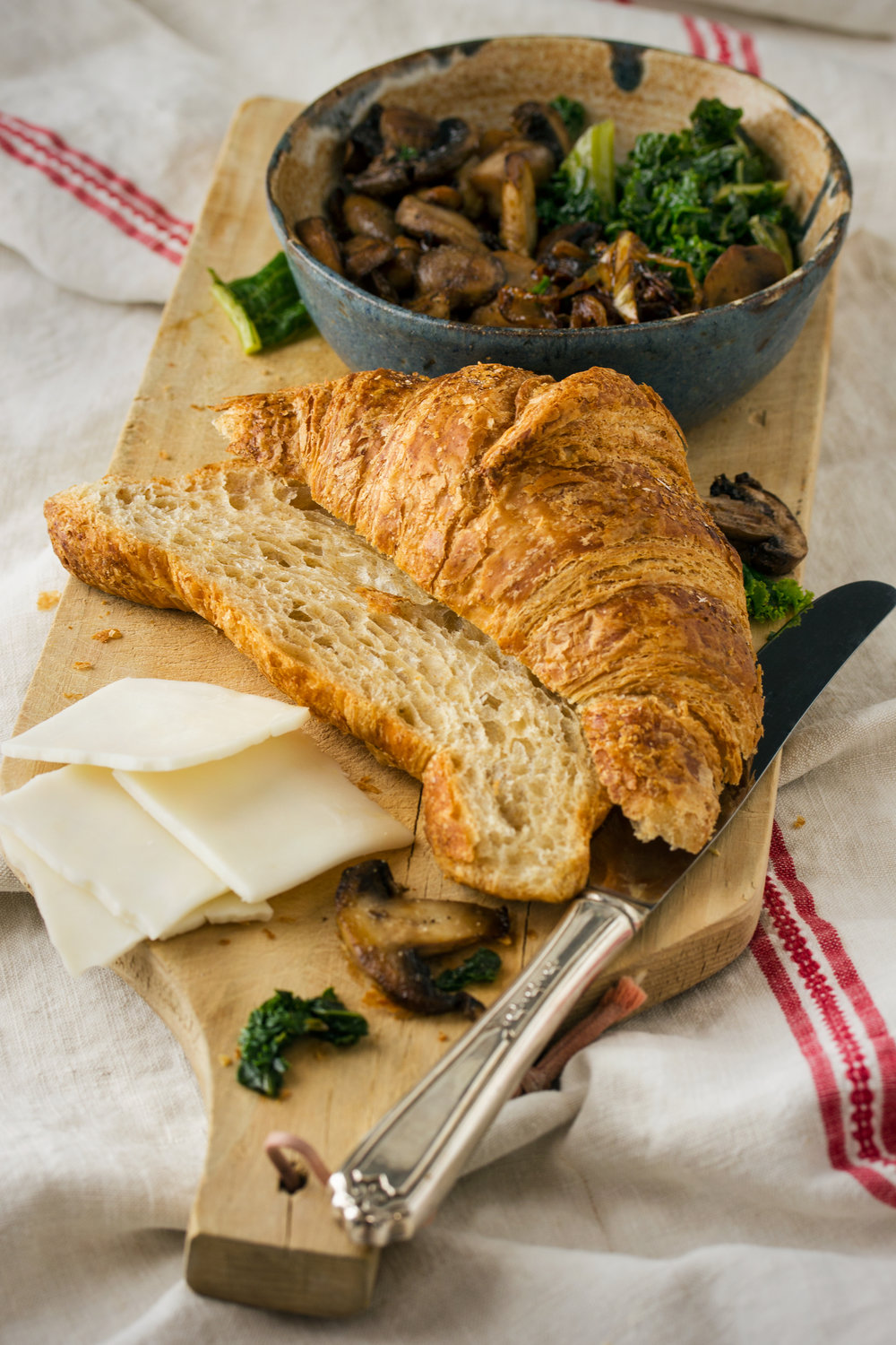Whole Wheat Croissant with Mushrooms, Kale, Caramelized Onions, and Goat Cheese