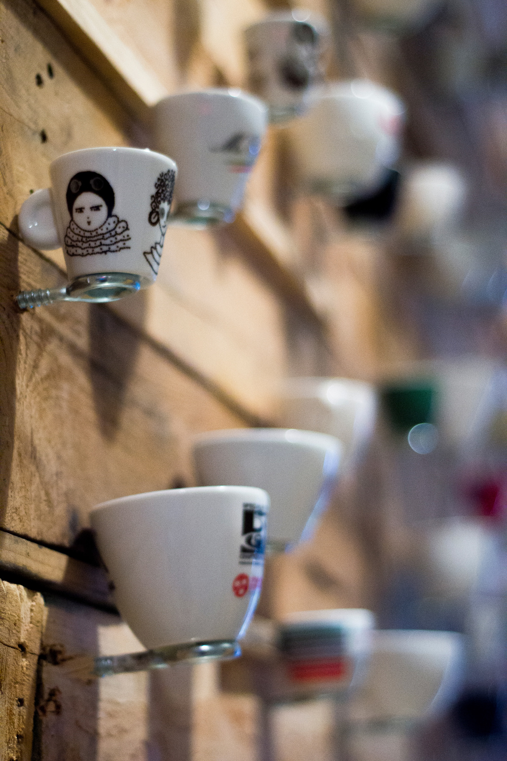 Our wall of espresso cups from around the world