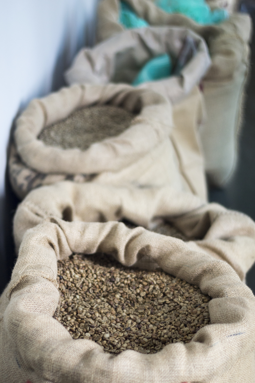 Our bags of green coffee at the shop waiting to be roasted