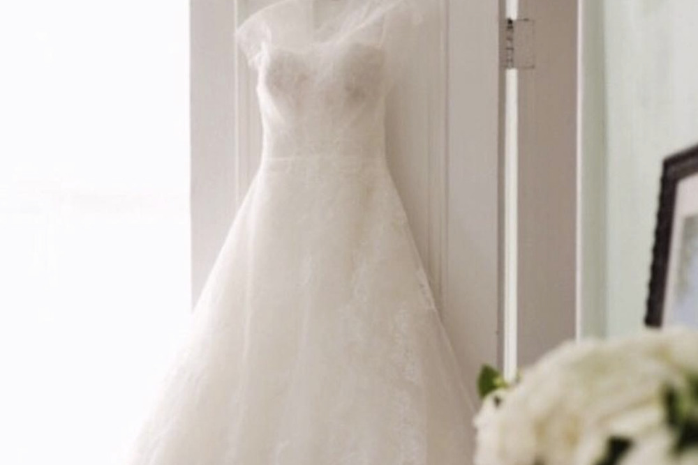 the Aisle Experience - Gown delivery the day of your wedding within the Triangle region. Priced at $500 and also includes:Pressing and steaming of gown and veil at your ceremony locationAssistance dressing the bride and styling accessoriesBustling of Gown after ceremony