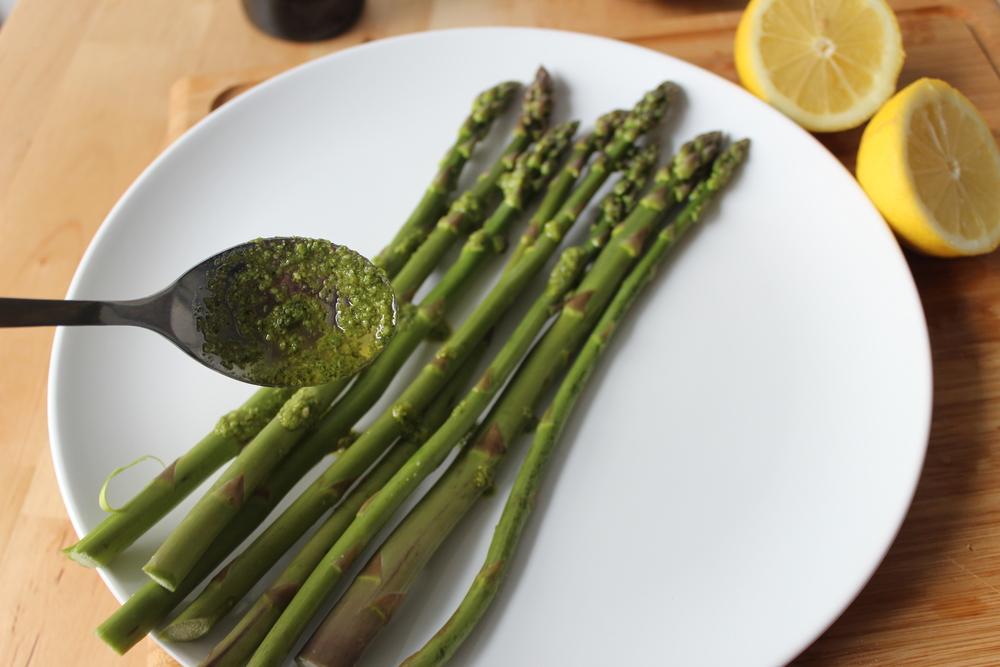 Spread the mix onto the asparagus.
