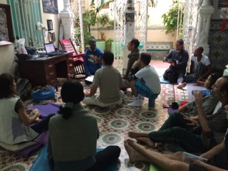 Rubio Cruz, YV2 Faculty, giving a presentation to YV2 participants in 2017 on his Abhyasa Yoga Programs in Holguin