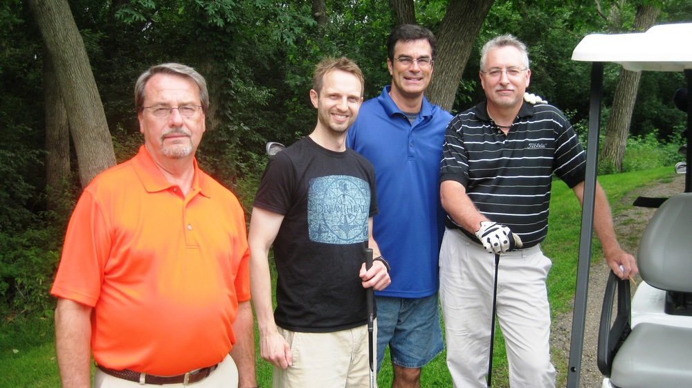 Gene, Brian, Dennis and Brandon - Golfing in style