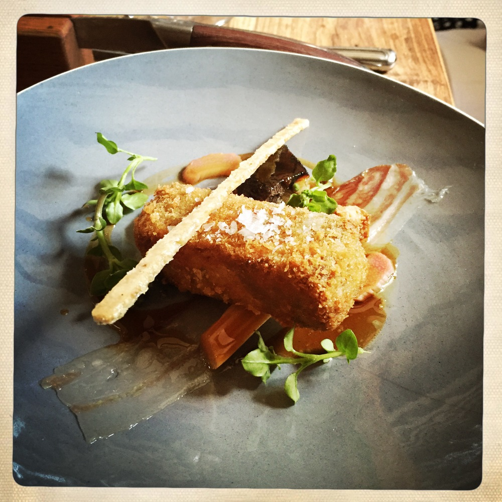 Crispy pig's head with rhubarb, pancetta & chickweed