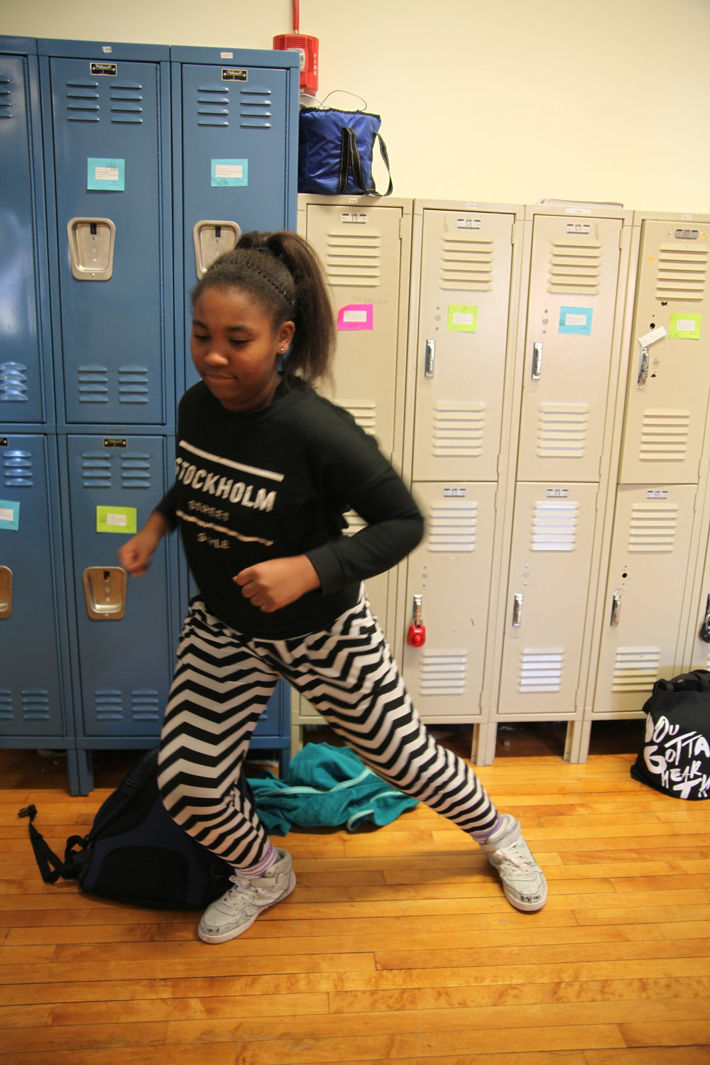 6th grader Vilmarie poses in one of her dance moves