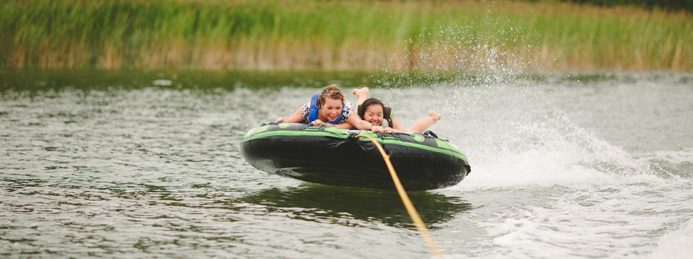 Tubing behind the boat at Camp Kadesh