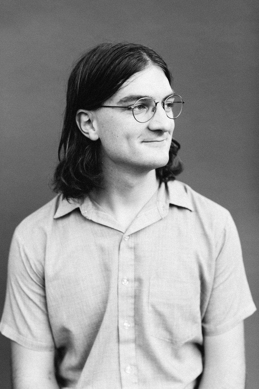 Photo of Aaron Lowell Denton at Anna Powell Teeter's studio in Bloomington, Indiana.
